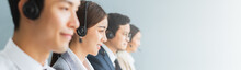 Banner Asian Team Call Center, Customer Service, Telesales In Casual With Headset Or Headphone And Look At Camera