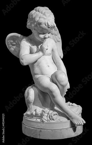 White angel figurine isolated on black background Fotobehang
