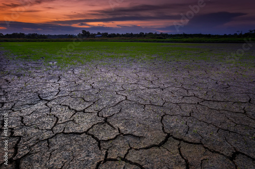 Papel de parede Dried Land Against Dramatic Sky At Sunset