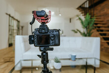 Camera With Microphone On The Tripod In The Living Room