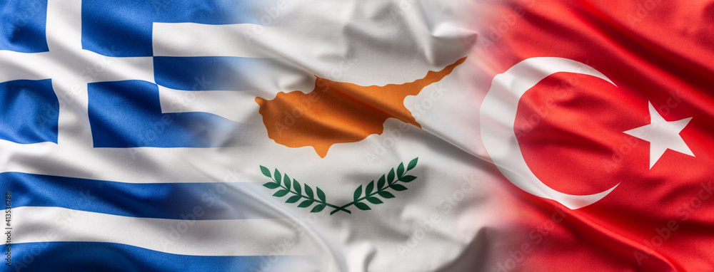 Fototapeta Greece< Cyprus and Turkey flags blowing in the wind
