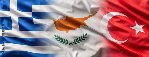 Fototapeta Greece< Cyprus and Turkey flags blowing in the wind obraz