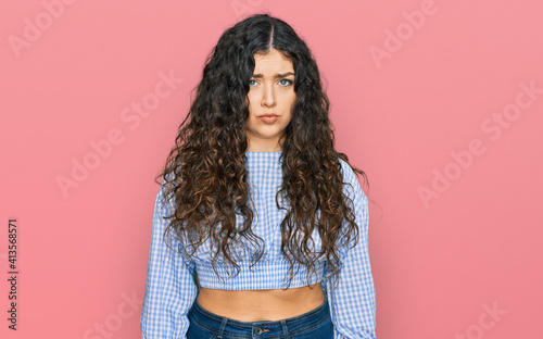 Canvastavla Young hispanic girl wearing casual clothes depressed and worry for distress, crying angry and afraid