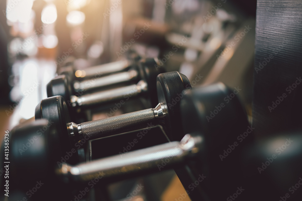 Fototapeta Exercise equipment dumbbell in the gym.