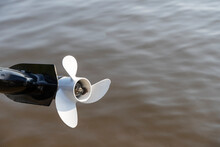 Outboard Motor On A Boat Over Water