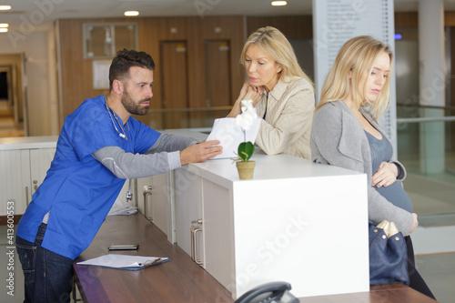 Fototapeta pregnant woman on reception at the doctors obraz