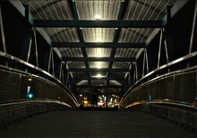 Diminishing Perspective Of Footbridge In City At Night