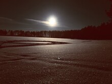 Scenic View Of Frozen Lake Against Sky At Night