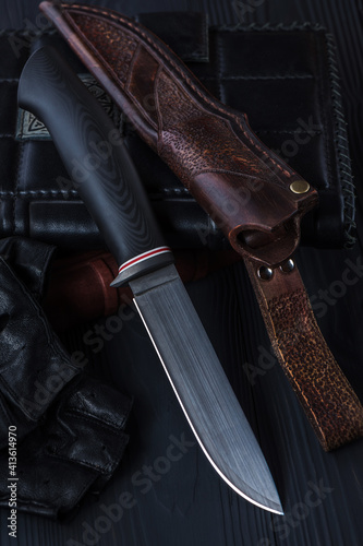 Papel de parede Hunting knife made of damascus steel on wooden background