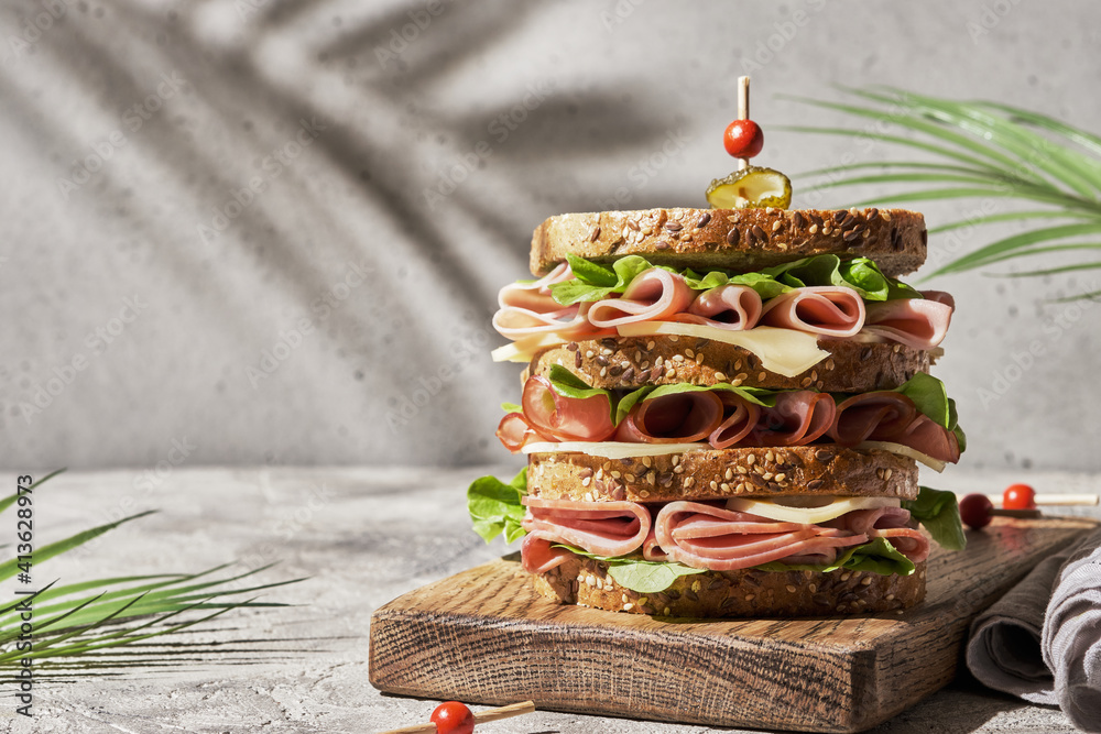 Fototapeta Fresh club sandwich with ham and cheese