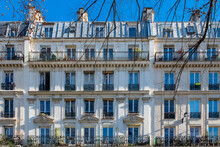 Paris, Typical Facade, Beautiful Building, With Heads Sculpted Above The Windows