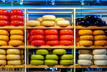 Assorted Colourful Wheels Of Cheese In A Rotterdam Market
