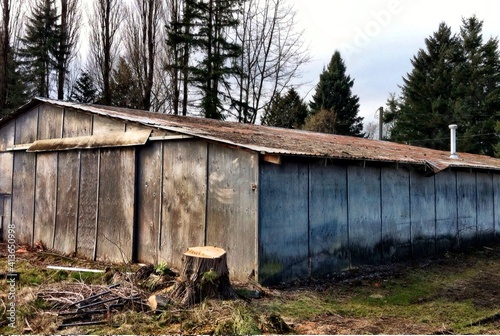 Exterior Of Barn By Trees Against Sky Poster Mural XXL