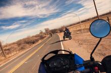 Bikers Seen Through Motorcycle Windshield At Desert Road