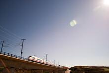 High Speed Train On Railway Bridge Against Clear Sky