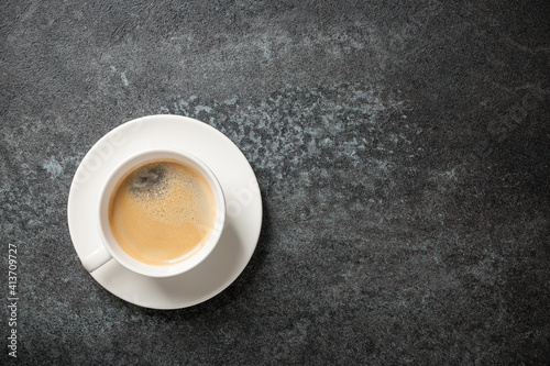 Fotografiet Cup of coffee on black background