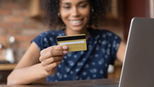 Close Up Happy African American Woman Paying Online By Credit Card, Using Laptop, Entering Information, Number, Satisfied Customer Shopping At Home, Checking Balance, Making Secure Internet Payment