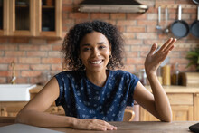 Head Shot Portrait Smiling African American Young Woman Waving Hand, Greeting, Chatting Online, Making Video Call, Involved In Conference, Blogger Influencer Recording Vlog In Kitchen At Home