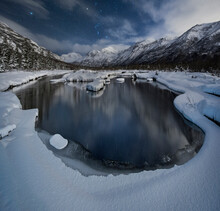Scenic View Of Lake Against Snowcapped Mountains At Chugach State Park During Night