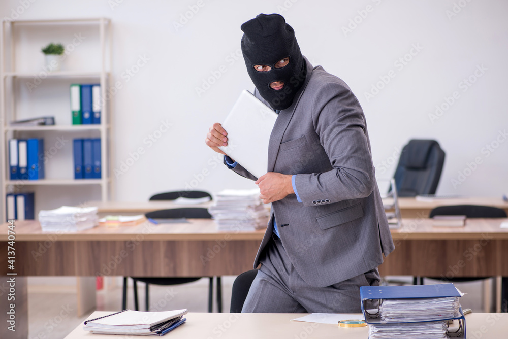 Fototapeta Young male employee in industrial espionage concept