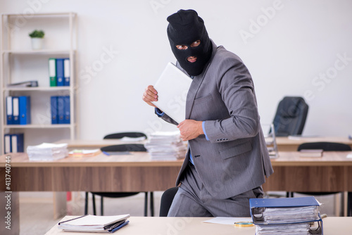 Fototapeta Young male employee in industrial espionage concept obraz