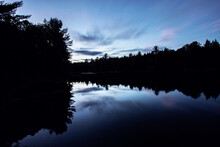 Long Exposure Of Trees In Silhouette, Penobscot River, Maine At Sunset