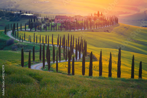 Fototapeta premium Admirable buildings in the grain fields at sunset, Tuscany, Italy