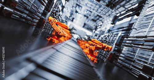Fototapeta Robotic arms along assembly line in modern factory. obraz