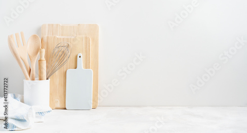 Canvas Print Kitchen background mockup with teepot and cooking, baking utensils rolling pin, cutboard, bowls on the table on white background