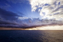 Cloudy Sky Over Seascape During Sunset
