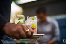 Cropped Image Of Waiter Holding Refreshing Drinks In Tray At Outdoor Restaurant