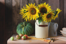 Rustic Still Life With Sunflowers And Pumpkin.