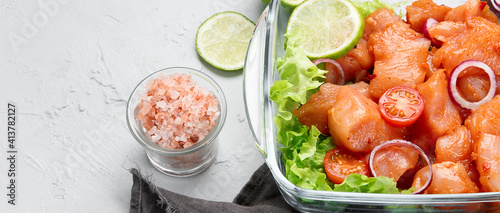 Obraz Raw and marinated chicken fillet on light background. Dietary meat. - fototapety do salonu