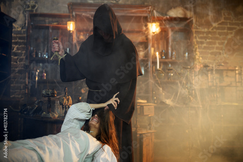 Canvas Print Exorcist casting out devil from creepy woman