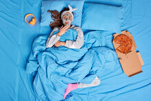 Photo Of Shocked Woman Applies Clay Mask On Face Doesnt Want To Get Up And Do Things Stays In Bed Realizes Terrifying News Covered Under Soft Blanket Relaxes In Cozy Bedroom Eats Delicious Pizza