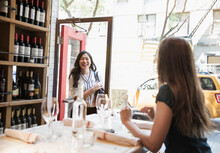Smiling Woman Looking At Colleague Sitting In Bar