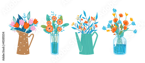 Foto Floral composition in bouquets, flowers in blossoms in decorative vases and water cans, glasses