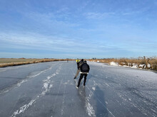 Ice Skating On A Frozen Canal In Friesland