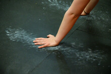 A Woman's Arms And Hands On A Chalked Up Floor During Crossfit.