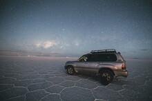 Car Under The Stars In Uyuni Salar
