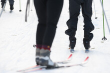 Three Skiers Heading Out To Ski At A Nordic Center