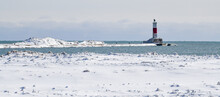 Snow Covered Winter Lake Shore Lighthouse