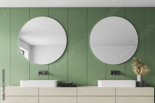 Fototapeta Light green bathroom with two sinks and mirrors, towels and faucets obraz na płótnie