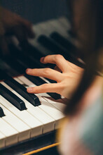 Close View Of Woman Hand On Piano Keys While Playing Music.