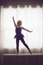 Tiny Dancer Fiercely Strikes Pose With Confidence.