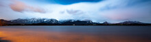 Long Exposure Panorama Of The Alps At Night With The Hopfensee In The Foreground
