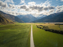 Straight Road Leading To Glacier In The Mountains In New Zealand