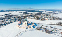 Aerial Drone View Of Pilgrimage Church Of Saint John Of Nepomuk, Zdar Nad Sazavou, Czech Republic. UNESCO Heritage. Ancient Monastery At Zelena Hora Hill. Winter Weather With Snow, Blue Sky.