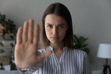 I Do Not Want. Portrait Of Strong Willed Millennial Woman Look At Camera Raise Palm In Gesture Of Prohibition. Young Lady Saying No Stop To Discrimination Abuse Domestic Violence. Focus On Female Face