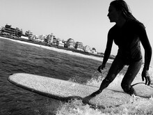 Close Up Silhouette View Of Female Surfer On Wave, Black And White